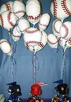 Baseball balloons float above hat and pennant centerpieces for baseball themed mitzvah