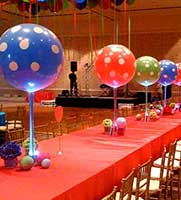 Large polka dot balloon sorbet centerpieces coordinate with flowers and tablecloth