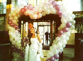 Seven foot tall walk-through Heart balloon sculpture entrance decoration for a wedding receptionr