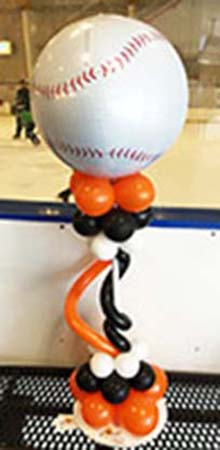 This sport-theme centerpiece consists of a 24 inch spire topped by a mylar baseball.  The spire is decorated with small round and elongated latex balloons in team colors.  This centerpiece can be customized for your sport and team celebration event.