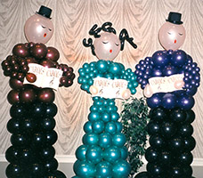This trio of six foot tall balloon sculpture carolers gives an old-fashioned Christmas theme look to your party