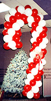 Balloonatics eight foot tall candy cane balloon sculpture speaks of both sweets and Christmas cheer