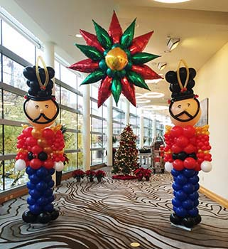 These six foot tall balloon sculpture Nutcrackers are an excellent area decoration communicating an old-fashioned Christmas event theme when placed around a venue.