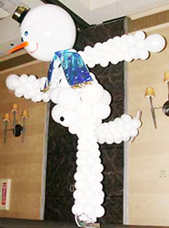 This six foot tall balloon sculpture snowman is joyfully skating for skating theme holiday party.