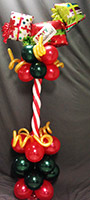 This 24 inch tall centerpiece is made of holiday color latex balloons topped by 'gift package' balloons.