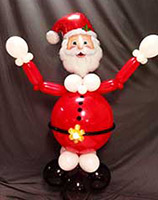 This bright red Santa Claus balloon sculpture comes complete with bearded face and cheerful smile and serves as a cheerful guest table or buffet table decoration