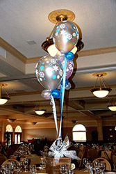 This bouquet centerpiece of three silver latex balloons adorned with snowflakes communicates a theme of simple elegance.
