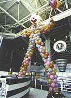 Giant clown serves as the entrance decoration for a corporate party at the HP Arena