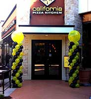 twin balloon columns flanking the entrance to California Pizza Kitchen for a promotion event