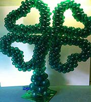Balloon sculpture of a four leaf clover used as decoration for meeting