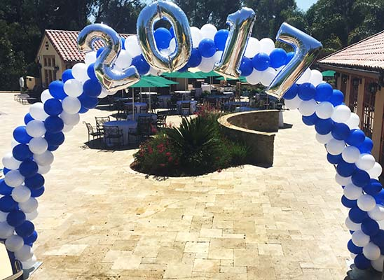 This spiral packed arch is the main decor piece for a class of 2017 pool party.