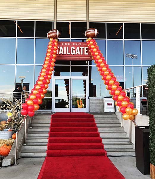 Two garlands in 49ers colors flanking the entrance to a tailgate event