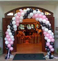 Swirled packed air balloon arch framing the entrance to an event venue