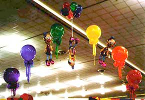 This playful balloon arch suspending an inverted clown was a decoration at a trade show