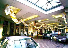 Garlands of gold, silver, white and clear balloons decorating the main entrance to the San Jose Fairmont Hotel for New Year's eve.