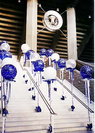 30 inch floating bubble balloons flanking entry stairs