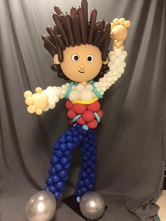 A 4' balloon sculpture of a boy with his