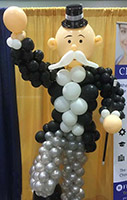 Balloonatics Old Big Bucks character balloon sculpture comes in formal dress wearing a ballon tuxedo with top hat and displays a classic large handlebar moustache