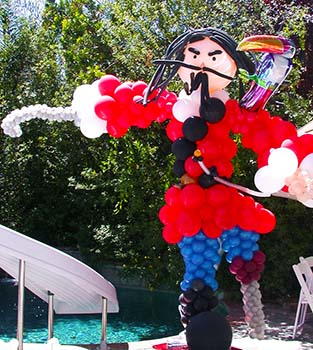 A six foot tall balloon sculpture of a peg leg pirate with a parrot on his shoulder.