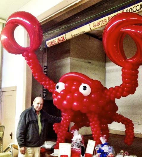 This giant 8' tall balloon sculpture of a red lobster is for a business promotion.