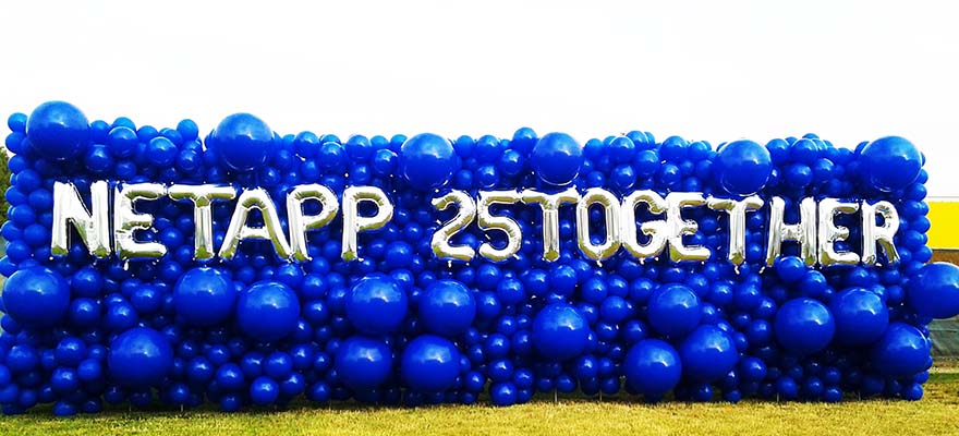 An 30 foot long balloon sign wall of varing size blue balloons giving an organic appearnce.