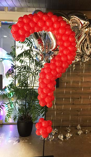 A giant six foot tall red balloon question mark detective theme event decoration for Quora Company in Mountain View, California