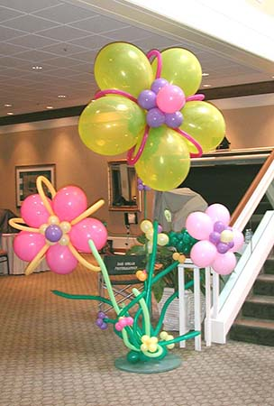 Our giant fantasy Fantasy Flower balloon sculptures range in size from four feet tall (for centerpieces) to eight feet tall for area decorations.  These yellow, pink, and mauve balloon flowers are used to decorate a staircase entrance for an Easter event