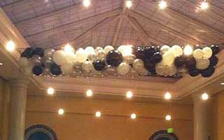 Net balloon drop of black and white colored balloons for a formal decor style event
