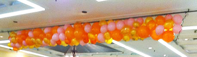 Net Style Drop of Orange and Gold Balloons