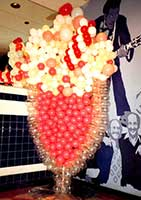 Balloon sculpture of a giant cherry soda in a crystal balloon glass brings back 50's memories