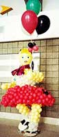 A lifesize 50's rocker girle balloon sculpture