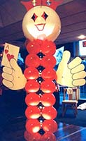 A 7 foot tall balloon column figure holding the ace of hearts serves as an area decoration for casino theme parties
