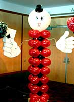 A 7 foot tall balloon column figure holding the ace of spades serves as an area decoration for casino theme parties