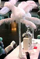 A carnival style casino table centerpiece of giant feathers