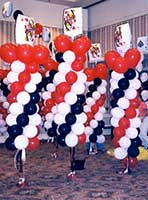 A red and black balloon column serves as an area decoration for casino theme events