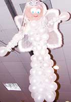 This pearl white balloon good fairy floats from a venue ceiling providing a decor that encompasses party goers from above