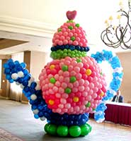 An 8 foot tall giant Mad Hatter's Teapot for Alice in Wonderland themem parties