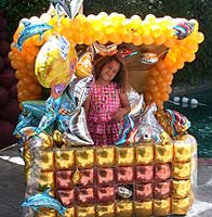 Balloon sculpture of a giant treasure chest to accent tales of pirates and bounty