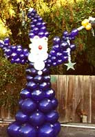 Balloon sculpture of a giant wizzard supports many tales of magic and mystery