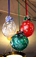 Balloon sculpture of a super size colorful holiday ornaments carries the holiday decor theme throughout this venue