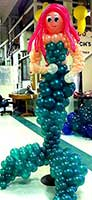 A 6 foot tall ballon mermaid sculpture adds a mystical look to this underwater theme party