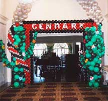 A pair of giant balloon sculpture cactus with a connecting balloon arch flanking the entrance to a western theme party