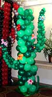 A giant balloon sculpture cactus is one of the area decorations at this western theme event
