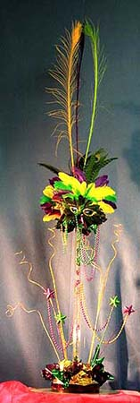 Carnival style centerpiece created with ting ting and feathers
