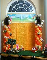 Custom designed beehive balloon columns for a childrens' event