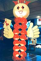 Casino greeter type columntopped by a large face balloon