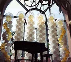 Columns serving as a background for a grand piano for a formal event at the San Jose Fairmont Hotel