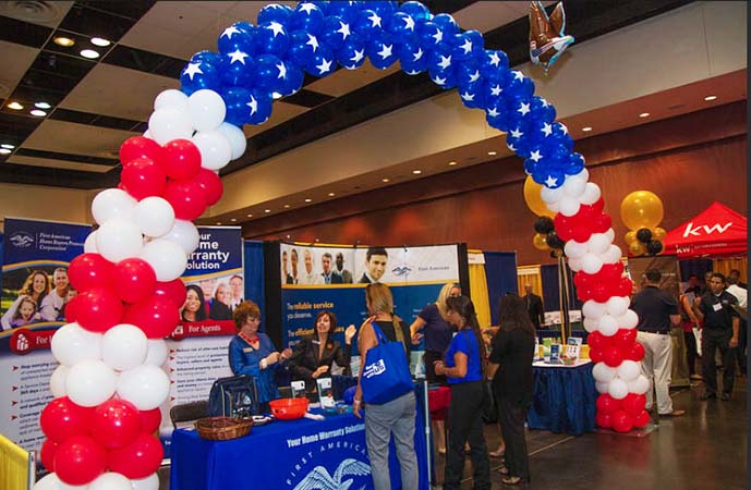 Giant Red, White and Blue arch decoration for a trade show booth